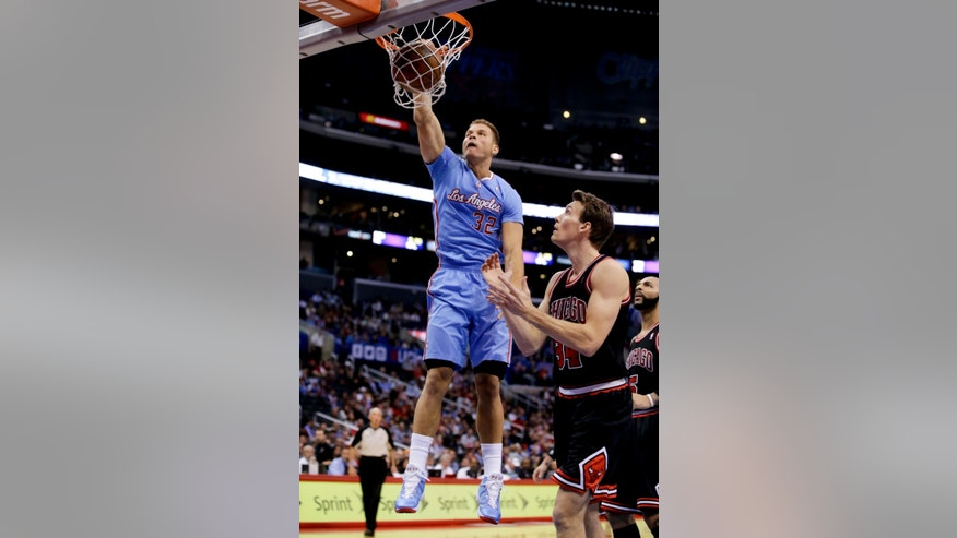 Los Angeles Clippers forward Blake Griffin, left, dunks as Chicago Bulls forward Mike Dunleavy looks on during the first half of an NBA basketball game in Los Angeles, Sunday, Nov. 24, 2013. (AP Photo/Chris Carlson)