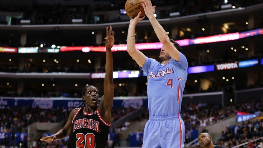 Los Angeles Clippers guard J.J. Redick (4) shoots over Chicago Bulls forward Tony Snell during the first half of an NBA basketball game in Los Angeles, Sunday, Nov. 24, 2013. (AP Photo/Chris Carlson)