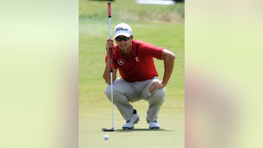 Adam Scott from Australia lines up a put on the fourth green during the third round of the World Cup of Golf at Royal Melbourne Golf Course in Australia, Saturday, Nov. 23, 2013. (AP Photo/Andy Brownbill)
