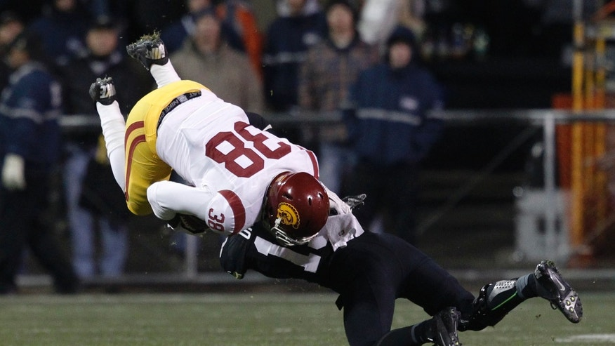 Southern California fullback Jahleel Pinner, left, is upended after a short gain by Colorado defensive back Parker Orms in the first quarter of an NCAA college football game in Boulder, Colo. Saturday, Nov. 23, 2013. (AP Photo/David Zalubowski)