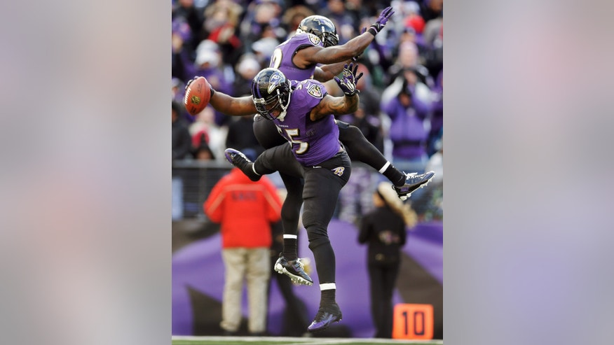 Baltimore Ravens outside linebacker Terrell Suggs (55) celebrates his fumble recovery with teammate strong safety James Ihedigbo during the first half of an NFL football game against the New York Jets in Baltimore, Md., Sunday, Nov. 24, 2013. (AP Photo/Patrick Semansky)