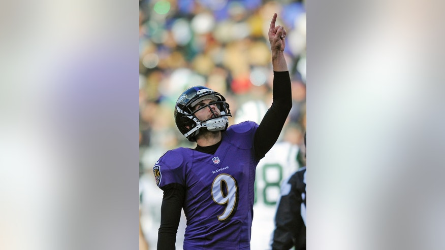 Baltimore Ravens kicker Justin Tucker reacts to his field goal during the first half of an NFL football game against the New York Jets in Baltimore, Md., Sunday, Nov. 24, 2013. (AP Photo/Nick Wass)