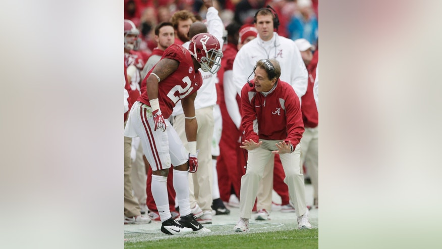 Alabama head coach Nick Saban talks with defensive back Maurice Smith (21) during the second half of an NCAA college football game against Chattanooga in Tuscaloosa, Ala., Saturday, Nov. 23, 2013. (AP Photo/Dave Martin)