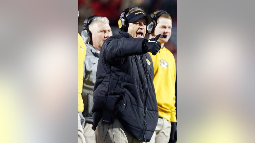 Missouri football coach Gary Pinkel yells at his players during the first half of an NCAA college football game against Mississippi, Saturday, Nov. 23, 2013, in Oxford, Miss. Missouri won 24-10. (AP Photo/Rogelio V. Solis)