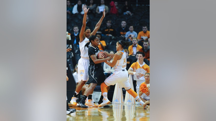 Tennessee's Andraya Carter (14) tries to take the ball from Oakland's Kim Bee as Tennessee's Mercedes Russell defends the goal in the first half of an NCAA college basketball game on Sunday, Nov. 24, 2013, in Knoxville, Tenn. (AP Photo/Patrick Murphy-Racey)