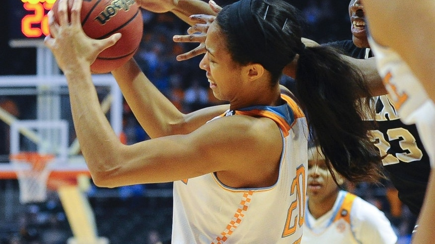 Oakland's Kim Bee (23) reaches for the ball in Tennessee's Isabelle Harrison's (20) hands in the first half of an NCAA college basketball game on Sunday, Nov. 24, 2013, in Knoxville, Tenn. (AP Photo/Patrick Murphy-Racey)