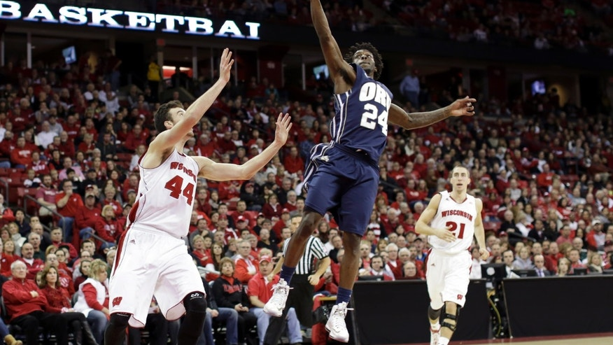 Oral Roberts' Korey Billbury (24) intercepts a pass intended for Wisconsin's Frank Kaminsky during the second half of an NCAA college basketball game on Saturday, Nov. 23, 2013, in Madison, Wis. Wisconsin won 76-67. (AP Photo/Andy Manis)