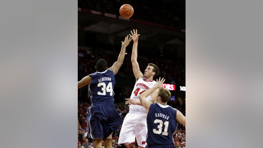 Wisconsin's Frank Kaminsky (44) shoots past Oral Roberts' Dennell Henderson (34) and Jorden Kaufman during the second half of an NCAA college basketball game on Saturday, Nov. 23, 2013, in Madison, Wis. Wisconsin won 76-67. (AP Photo/Andy Manis)
