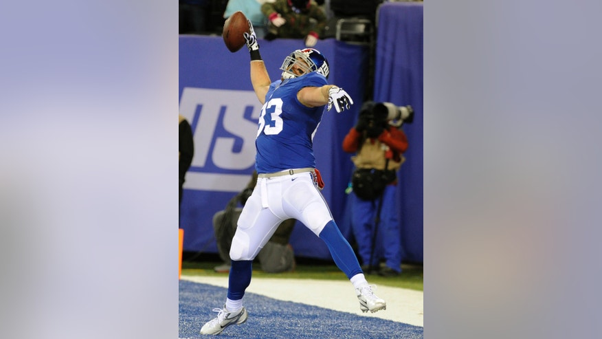 New York Giants tight end Brandon Myers celebrates after scoring on a touchdown catch against the Dallas Cowboys during the second half of an NFL football game, Sunday, Nov. 24, 2013, in East Rutherford, N.J. (AP Photo/Bill Kostroun)