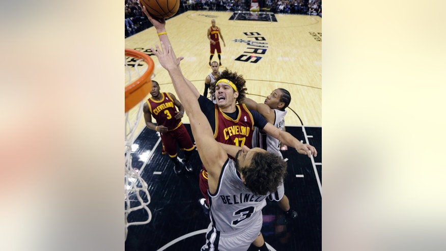 Cleveland Cavaliers' Anderson Varejao (17) shoots over San Antonio Spurs' Marco Belinelli (3), of Italy, during the first half of an NBA basketball game Saturday, Nov. 23, 2013, in San Antonio. (AP Photo/Eric Gay)