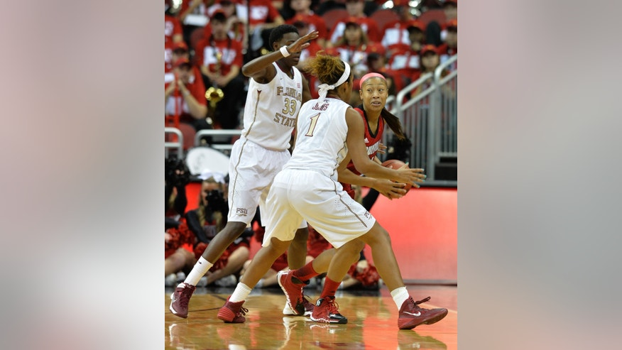 Louisville's Antonita Slaughter, right, looks for help from the defense of Florida State's Natasha Howard, left and Morgan Jones during the first half of their NCAA college basketball game onSunday Nov. 24, 2013, in Louisville, Ky. (AP Photo/Timothy D. Easley)