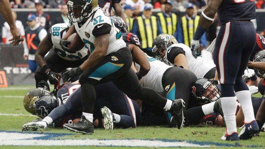 Jacksonville Jaguars running back Maurice Jones-Drew (32) runs to the end zone foe a touchdown during the first quarter an NFL football game against the Houston Texans Sunday, Nov. 24, 2013, in Houston. (AP Photo/Patric Schneider)