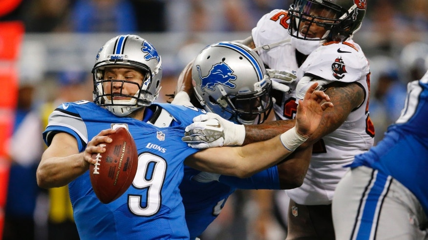 Tampa Bay Buccaneers outside linebacker Jonathan Casillas, right, reaches in on Detroit Lions quarterback Matthew Stafford (9) during the fourth quarter of an NFL football game at Ford Field in Detroit, Sunday, Nov. 24, 2013. (AP Photo/Paul Sancya)