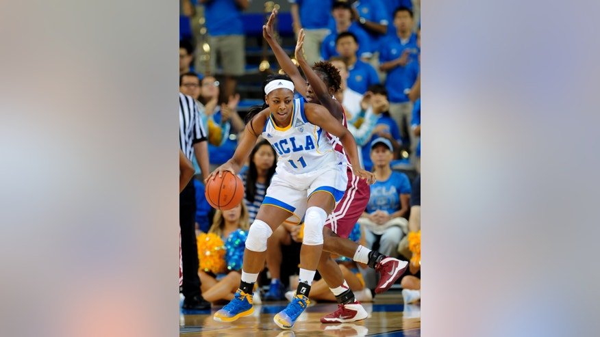 UCLA forward Atonye Nyingifa (11) drives on Oklahoma guard Sharane Campbell, back, during the first half of an NCAA college basketball game, Sunday, Nov. 24, 2013, in Los Angeles. (AP Photo/Gus Ruelas)