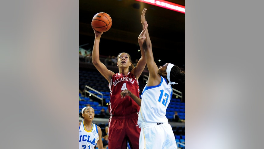 Oklahoma center Nicole Griffin (4) battles UCLA center Luiana Livulo (13) for a basket during the first half of an NCAA college basketball game, Sunday, Nov. 24, 2013, in Los Angeles. (AP Photo/Gus Ruelas)