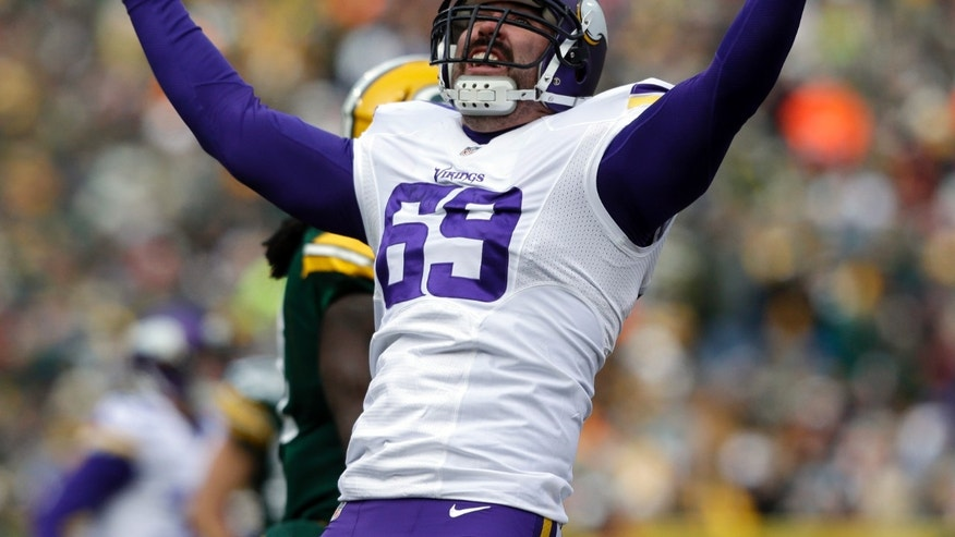Minnesota Vikings' Jared Allen reacts after sacking Green Bay Packers quarterback Scott Tolzien during the first half of an NFL football game Sunday, Nov. 24, 2013, in Green Bay, Wis. (AP Photo/Jeffrey Phelps)