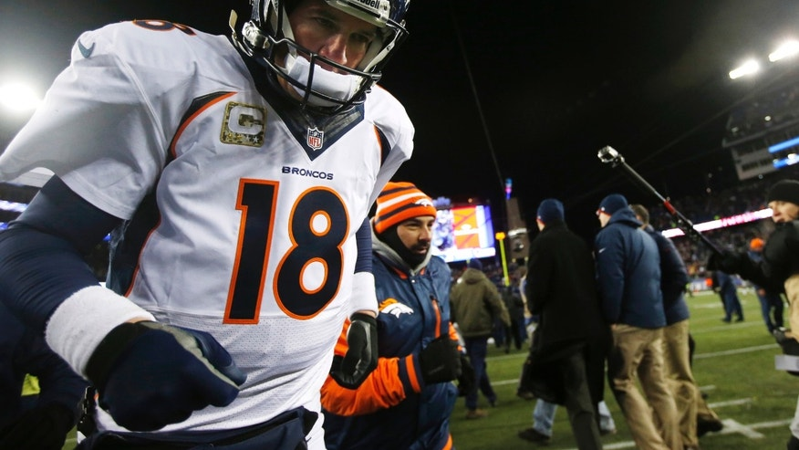 Denver Broncos quarterback Peyton Manning leaves the field after losing 34-31 to the New England Patriots in overtime of an NFL football game early Monday, Nov. 25, 2013, in Foxborough, Mass.  (AP Photo/Elise Amendola)