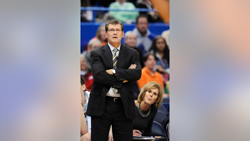 Connecticut head coach Geno Auriemma, left, and associate head coach Chris Dailey watch action during the second half of Connecticut's 88-39 victory over St. Bonaventure in an NCAA college basketball game in Hartford, Conn., on Sunday, Nov. 24, 2013. (AP Photo/Fred Beckham)