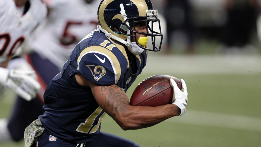 St. Louis Rams wide receiver Tavon Austin runs for a 65-yard touchdown during the first quarter of an NFL football game against the Chicago Bears on Sunday, Nov. 24, 2013, in St. Louis. (AP Photo/Tom Gannam)