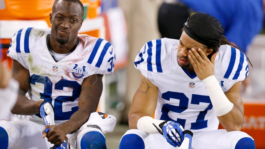 Indianapolis Colts' Josh Gordy (27) and Cassius Vaughn (32) sit on the bench during the second half of an NFL football game against the Arizona Cardinals Sunday, Nov. 24, 2013, in Glendale, Ariz.  The Cardinals defeated the Colts 40-11. (AP Photo/Ross D. Franklin)