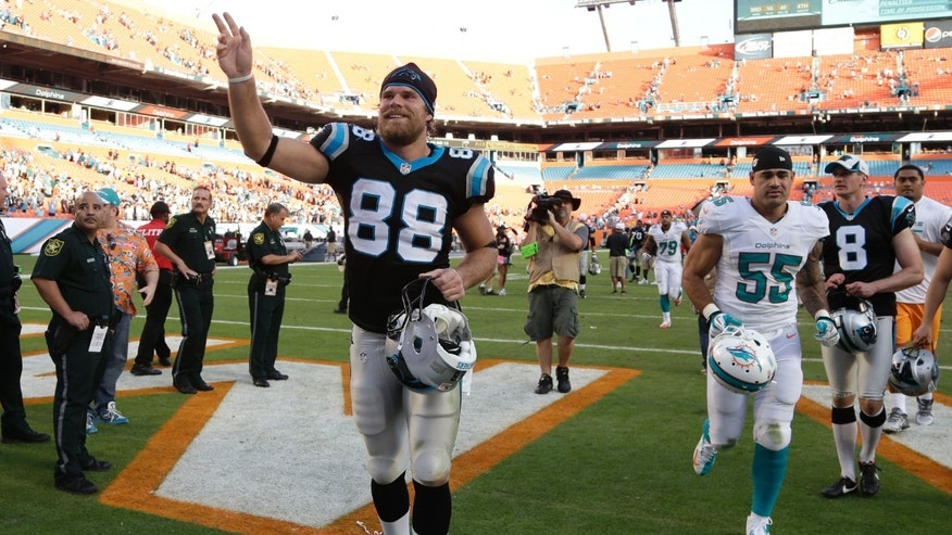 Carolina Panthers tight end Greg Olsen (88) waves as he walks off the field after an NFL football game against the Miami Dolphins, Sunday, Nov. 24, 2013, in Miami Gardens, Fla. Olsen scored the winning touchdown as the Panthers defeated the Dolphins 20-16. (AP Photo/Lynne Sladky)