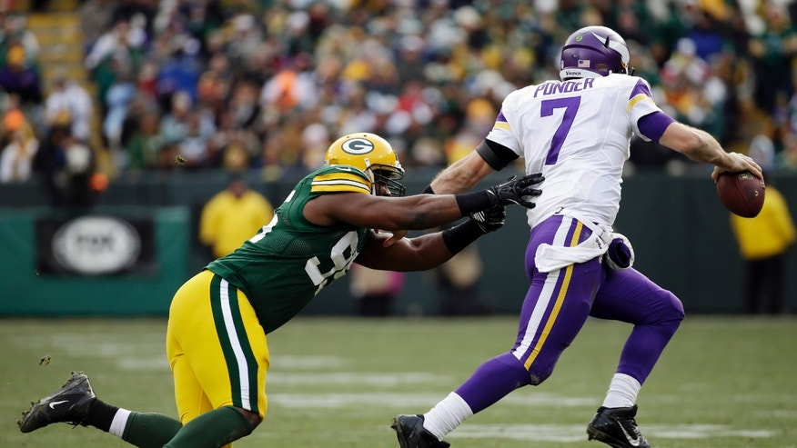 Minnesota Vikings' Christian Ponder tries to get away from Green Bay Packers' Datone Jones during the second half of an NFL football game Sunday, Nov. 24, 2013, in Green Bay, Wis. (AP Photo/Mike Roemer)