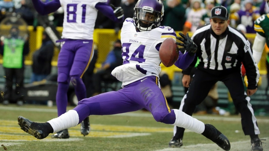 Minnesota Vikings' Cordarrelle Patterson can't handle a pass in the back of the end zone during overtime an NFL football game against the Green Bay Packers Sunday, Nov. 24, 2013, in Green Bay, Wis. The game ended in a tie, 26-26. (AP Photo/Morry Gash)