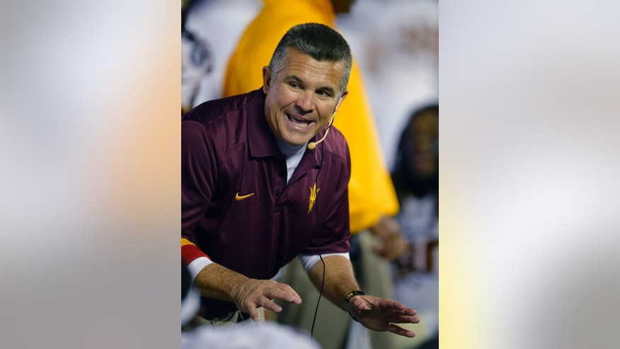 Arizona State head coach Todd Graham talks to his team during the second half an NCAA college football game against UCLA, Saturday, Nov. 23, 2013, in Pasadena, Calif. (AP Photo/Mark J. Terrill)