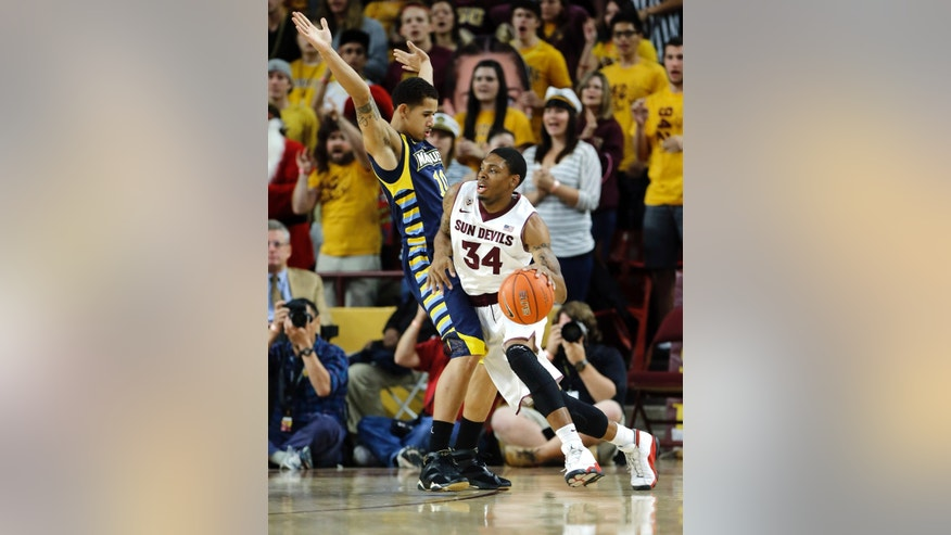 Arizona State guard Jermaine Marshall (34) drives against Marquette guard Juan Anderson (10) during the first half of an NCAA basketball game, Monday, Nov. 25, 2013, in Tempe, Ariz. (AP Photo/Matt York)