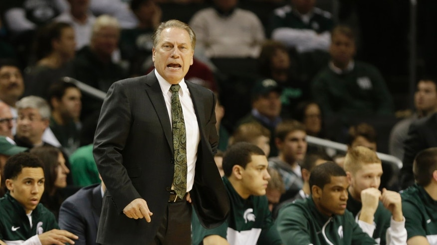 Michigan State head coach Tom Izzo calls out to his team during the first half of the championship game against Oklahoma in the Coaches vs. Cancer NCAA college basketball game on Saturday, Nov. 23, 2013, in New York. (AP Photo/Frank Franklin II)
