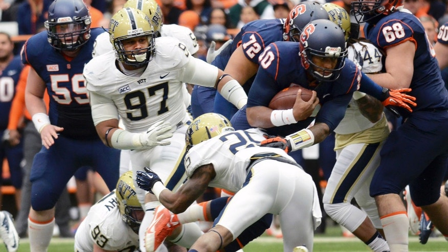 Pittsburgh's Aaron Donald, 97, goes after Syracuse's Terrell Hunt, 10, during the team's 17-16 win over Syracuse in Syracuse, N.Y., Saturday, Nov. 23, 2013. (AP Photo/Heather Ainsworth)