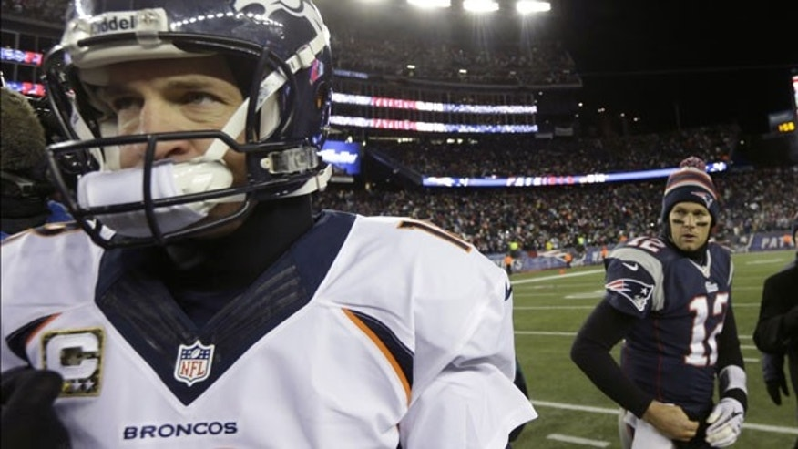 November 25, 2013: Denver Broncos quarterback Peyton Manning, left, walks from New England Patriots quarterback Tom Brady after an NFL football game in Foxborough, Mass. The Patriots won 34-31 in overtime. (AP Photo/Steven Senne)