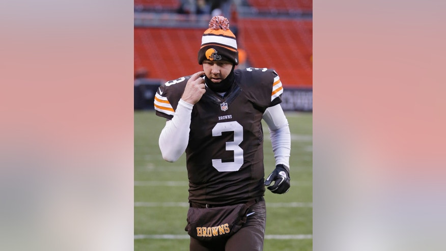 Cleveland Browns quarterback Brandon Weeden jogs off the field after a 27-11 loss to the Pittsburgh Steelers in an NFL football game on Sunday, Nov. 24, 2013, in Cleveland. (AP Photo/Tony Dejak)