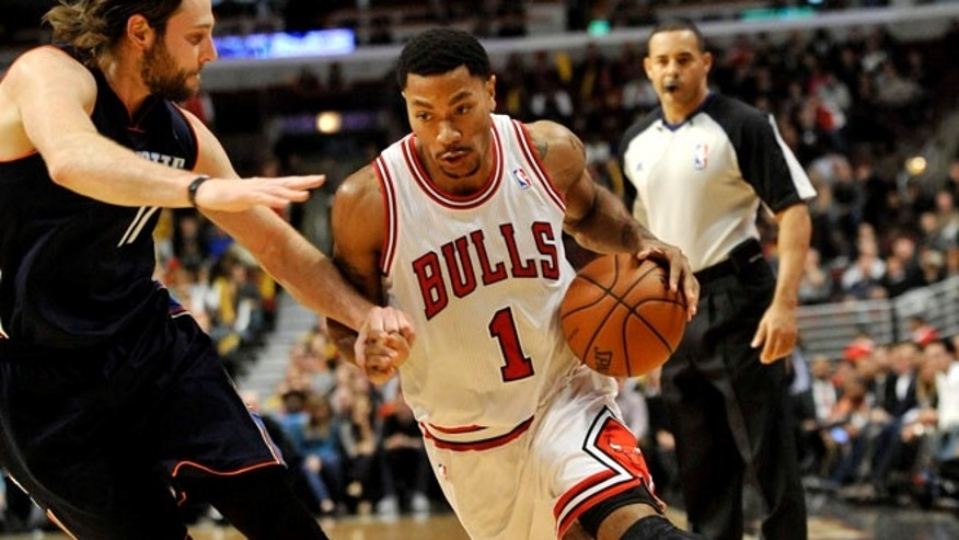 Nov. 18, 2013: Chicago Bulls' Derrick Rose (1), drives around Charlotte Bobcats' Josh McRoberts (11), during the fourth quarter of an NBA basketball game in Chicago.