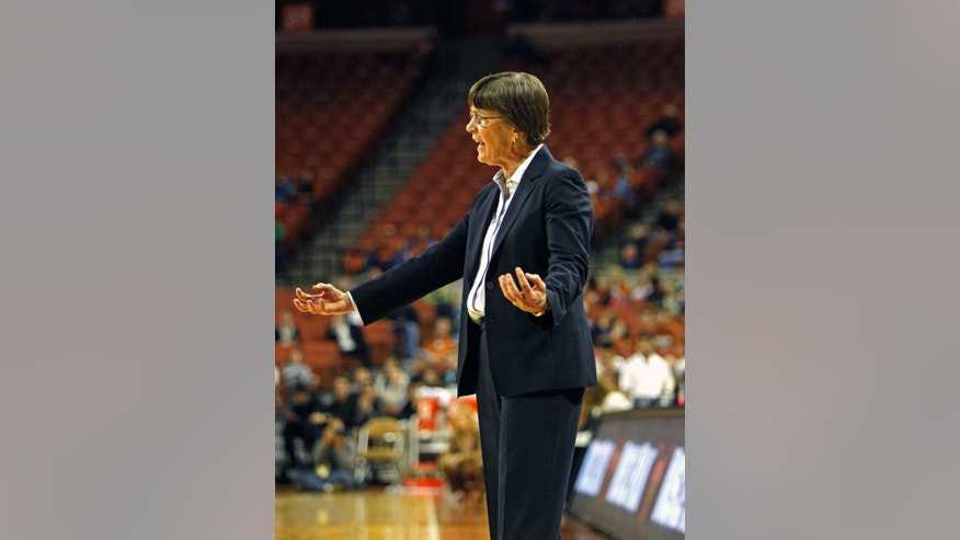 Stanford head coach Tara Vanderveer calls out to her team during the second half of an NCAA college basketball game against Texas, Saturday, Nov. 23, 2013, in Austin, Texas. Stanford won 63-54. (AP Photo/Michael Thomas)