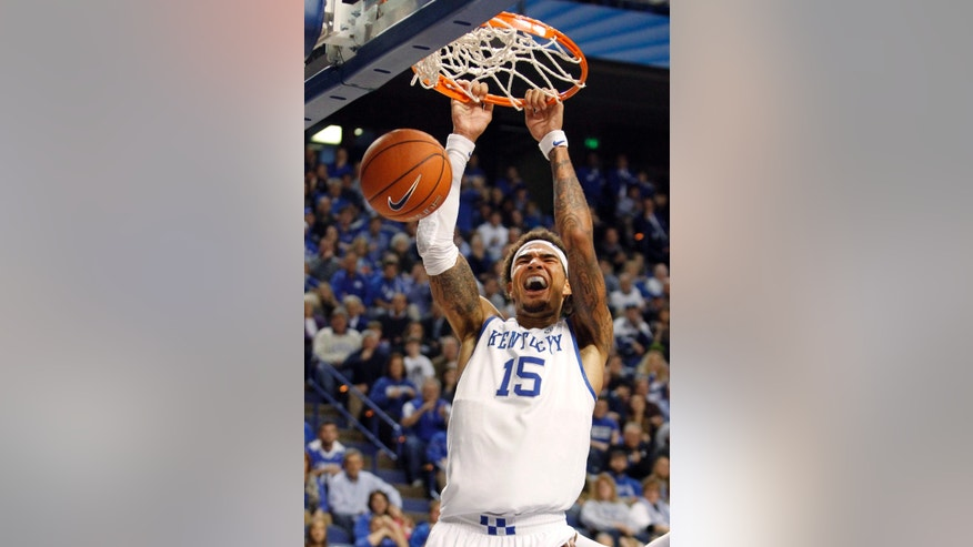 Kentucky's Willie Cauley-Stein (15) reacts after his dunk during the second half of an NCAA college basketball game against Cleveland State, Monday, Nov. 25, 2013, in Lexington, Ky. Kentucky won 68-61. (AP Photo/James Crisp)