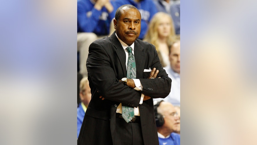 Cleveland State head coach Gary Waters watches his team during the first half of an NCAA college basketball game against Kentucky, Monday, Nov. 25, 2013, in Lexington, Ky. (AP Photo/James Crisp)