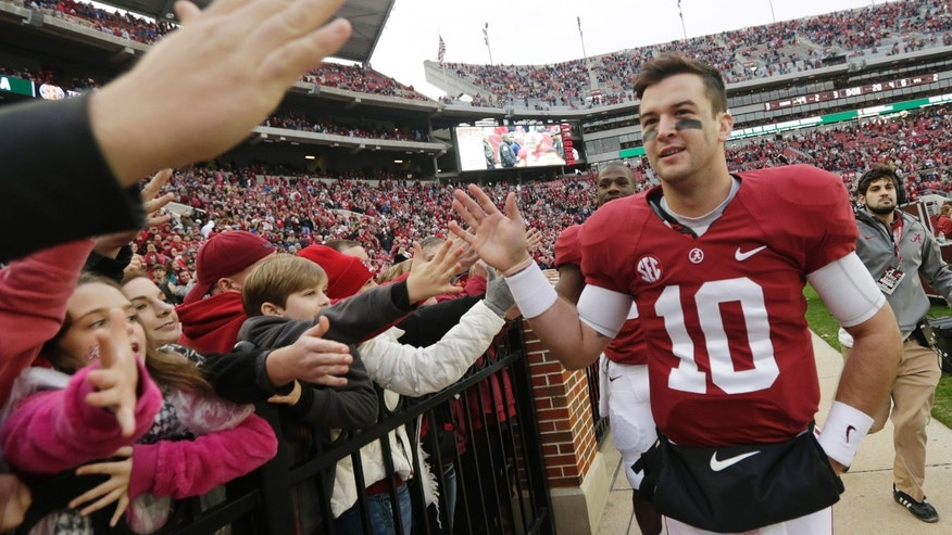 Alabama quarterback AJ McCarron (10) celebrates with fans after a 49-0 win over Chattanooga in an NCAA college football game in Tuscaloosa, Ala., Saturday, Nov. 23, 2013. (AP Photo/Dave Martin)