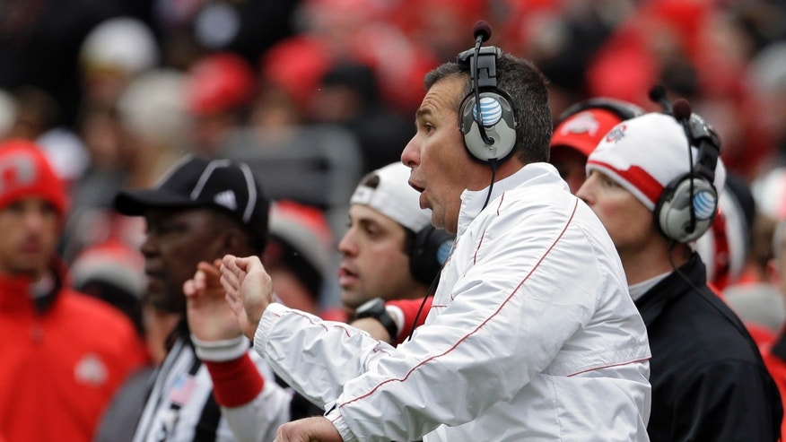 FILE - In this Nov. 24, 2012 file photo, Ohio State head coach Urban Meyer signals his offense in an NCAA college football game against Michigan in Columbus, Ohio. It has already been a successful season for No. 3 Ohio State, but as the Buckeyes know, no season is a success if they lose to their chief rivals, the Michigan Wolverines. (AP Photo/Mark Duncan, File)