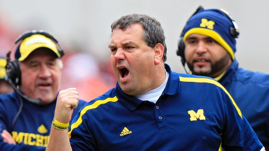 FILE - In this Nov. 24, 2012 file photo, Michigan head coach Brady Hoke yells at his team in an NCAA college football game against Ohio State in Columbus, Ohio. It has already been a successful season for No. 3 Ohio State, but as the Buckeyes know, no season is a success if they lose to their chief rivals, the Michigan Wolverines. (AP Photo/Jay LaPrete, File)