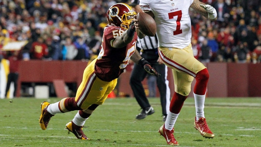 San Francisco 49ers quarterback Colin Kaepernick runs out of the reach of Washington Redskins inside linebacker Perry Riley during the first half of an NFL football game in Landover, Md., Monday, Nov. 25, 2013. (AP Photo/Alex Brandon)