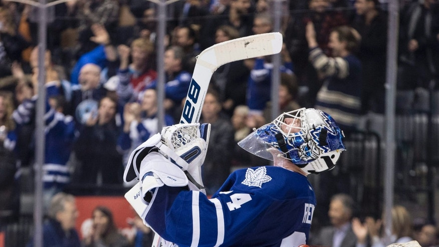 Toronto Maple Leafs goaltender James Reimer celebrates after saving a shot from Washington Capitals' Troy Brouwer to win during shootout NHL hockey action in Toronto on Saturday, Nov. 23, 2013. Toronto won 2-1. (AP Photo/The Canadian Press, Chris Young)