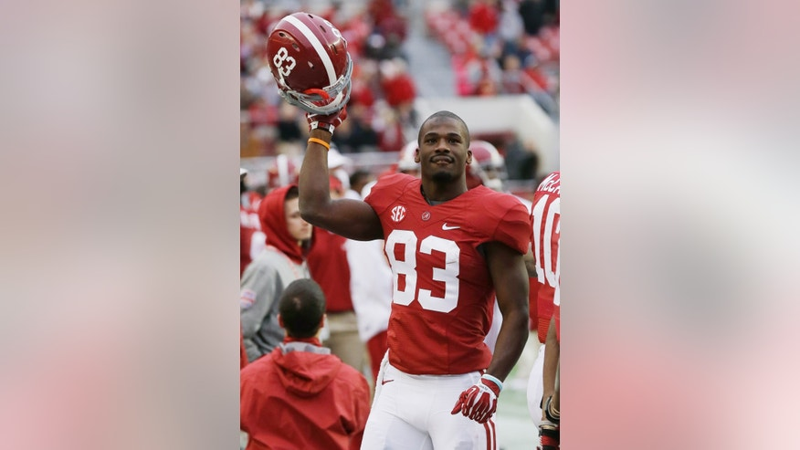 Alabama wide receiver Kevin Norwood (83) reacts near the end of a 49-0 win over Chattanooga during the second half of an NCAA college football game in Tuscaloosa, Ala., Saturday, Nov. 23, 2013.(AP Photo/Dave Martin)