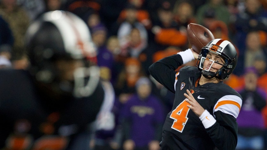 Oregon State Beavers quarterback Sean Mannion (4) passes as the Beavers fell behind, 27-0, at the half against the Washington Huskies at Reser Stadium in Corvallis Saturday Nov. 23, 2013. (AP Photo/The Oregonian, Randy L. Rasmussen)