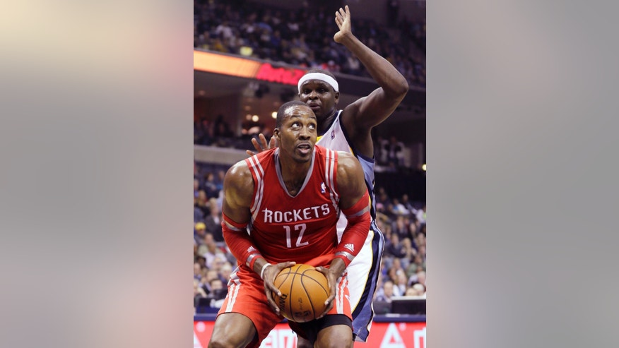 Houston Rockets' Dwight Howard (12) is defended by Memphis Grizzlies' Zach Randolph in the first half of an NBA basketball game in Memphis, Tenn., Monday, Nov. 25, 2013. (AP Photo/Danny Johnston)