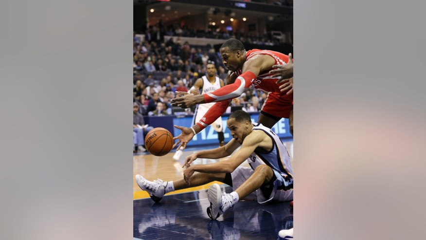 Memphis Grizzlies' Tayshaun Prince, bottom and Houston Rockets' Dwight Howard, top, reach for a loose ball in the first half of an NBA basketball game in Memphis, Tenn., Monday, Nov. 25, 2013. (AP Photo/Danny Johnston)