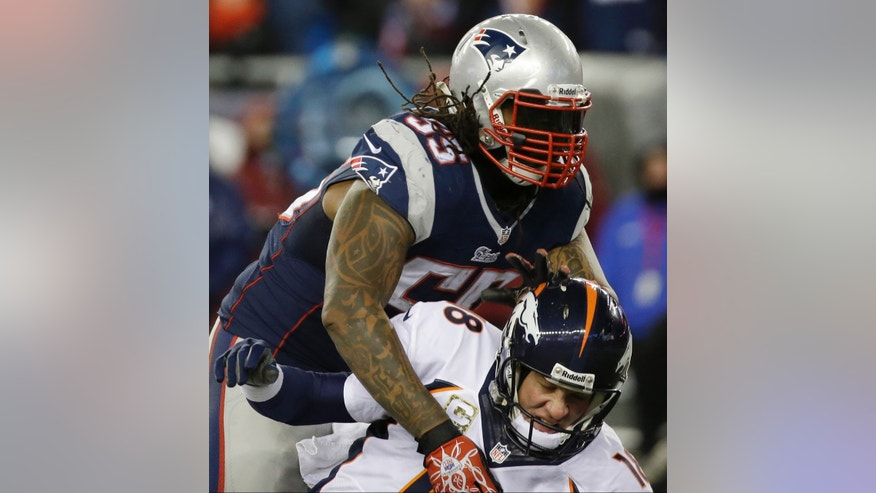 New England Patriots middle linebacker Brandon Spikes (55) knocks down Denver Broncos quarterback Peyton Manning (18) in the fourth quarter of an NFL football game Sunday, Nov. 24, 2013, in Foxborough, Mass. (AP Photo/Stephan Savoia)