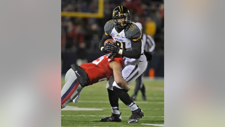 Missouri tight end Eric Waters (81) is wrapped up by Mississippi defensive back Cody Prewitt (25) during the fourth quarter of an NCAA college football game on Saturday, Nov. 23, 2013, in Oxford, MS. #8 Missouri beat #24 Mississippi 24-10. (AP Photo/ The Daily Mississippian, Austin McAfee)