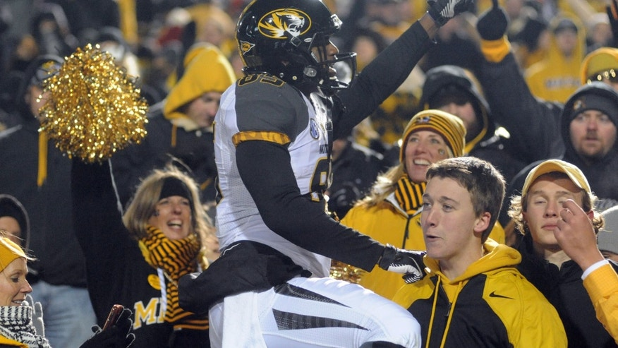 Missouri's Marcus Lucas (85) celebrates a win over Mississippi at Vaught-Hemingway Stadium in Oxford, Miss. on Saturday, Nov. 23, 2013. Missouri won 24-10. (AP Photo/Oxford Eagle, Bruce Newman)