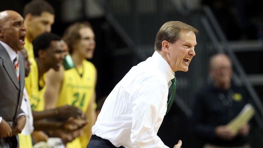 Oregon Head Coach Dana Altman yells encouragement to his team during their game against San Francisco during the first half of an NCAA college basketball game in Eugene on Sunday, Nov. 24, 2013. (AP Photo/Chris Pietsch)